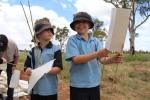 Courtenay Langford and Bella Davies from Crookwell Primary School enjoying making the tree guards.