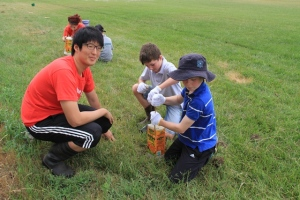 International Volunteer Jooho Song from South Korea assisting Jacob McIntosh and Lewis Golding.