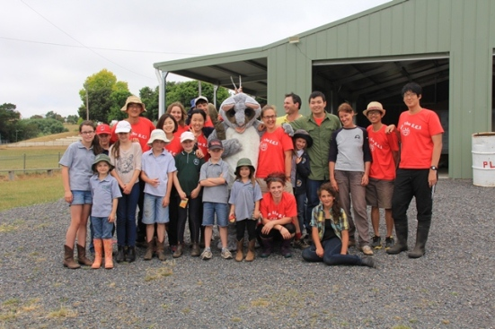 "International Volunteers, Helen Ward, Taralga and Tambelin Students with ""Pesky Possum"""