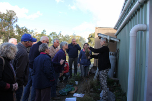 Rural Educator Alison Elvin showing  Grabben Gullen TT workshop participants how to identify weeds and weed look alikes